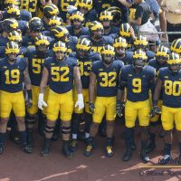 Michigan players waiting in the tunnel to run under the Go Blue banner. Photo: Mark Kolanowski/MGoFish