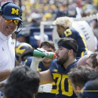 Greg Frey coaching the offensive line against Cincinnati at Michigan Stadium in Ann Arbor, Michigan on September 9th, 2017. Photo: Mark Kolanowski/MGoFish