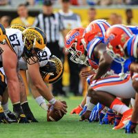 ORLANDO, FL - JANUARY 01: Michigan Wolverines and Florida Gators players line up before a snap during the second half of the Buffalo Wild Wings Citrus Bowl game at Orlando Citrus Bowl on January 1, 2016 in Orlando, Florida. (Photo by Rob Foldy/Getty Images)