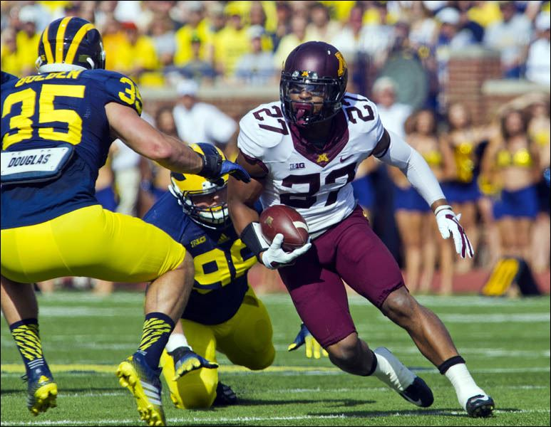 Minnesota running back David Cobb (27) rushes in the first quarter of an NCAA college football game against Michigan. ASSOCIATED PRESS