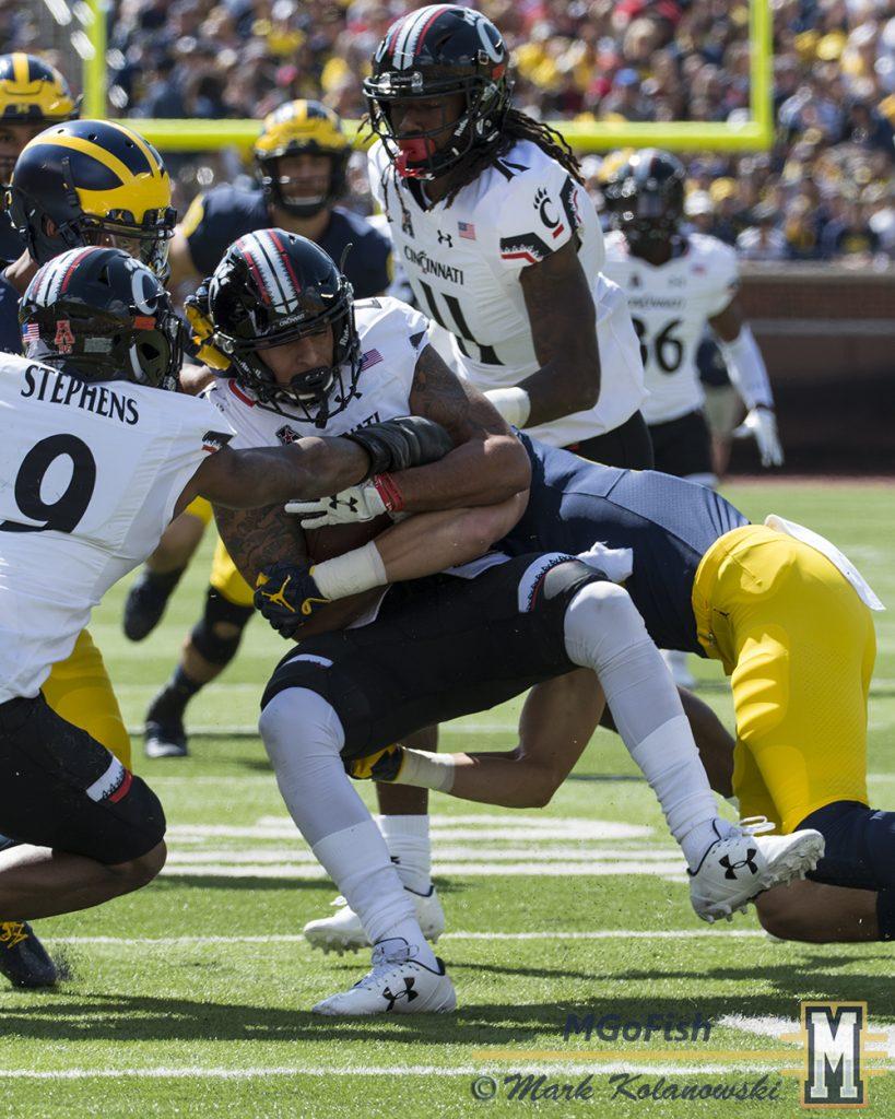 Nate Schoenle special teams tackle against Cincinnati at Michigan Stadium in Ann Arbor, Michigan on September 9th, 2017. Photo: Mark Kolanowski/MGoFish