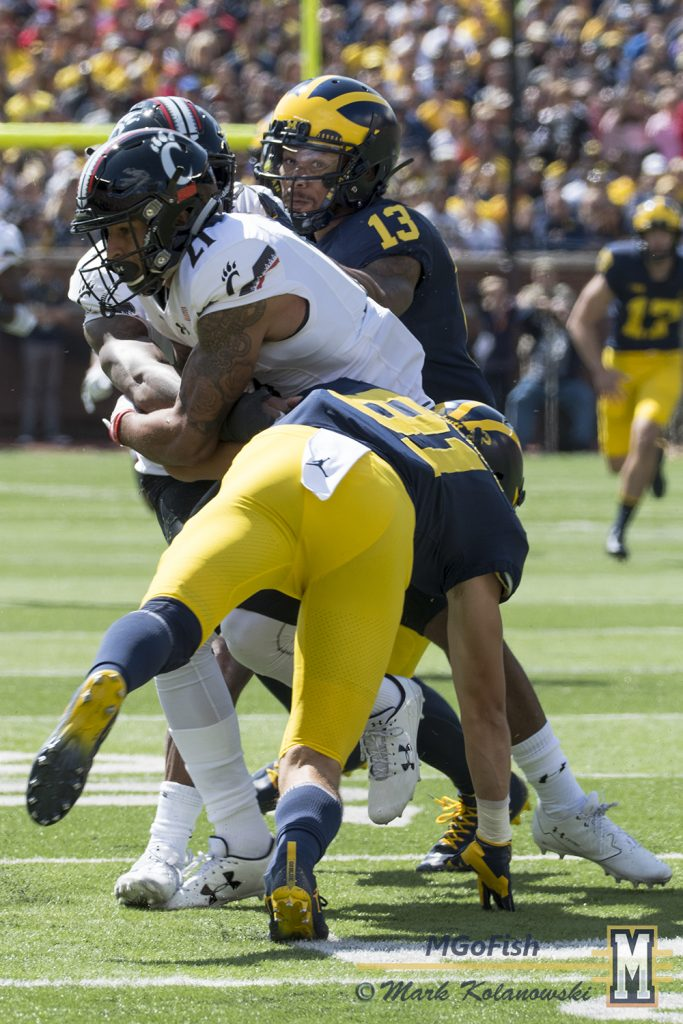 Eddie McDoom and Nate Schoenle team up for a special teams tackle against Cincinnati at Michigan Stadium in Ann Arbor, Michigan on September 9th, 2017. Photo: Mark Kolanowski/MGoFish