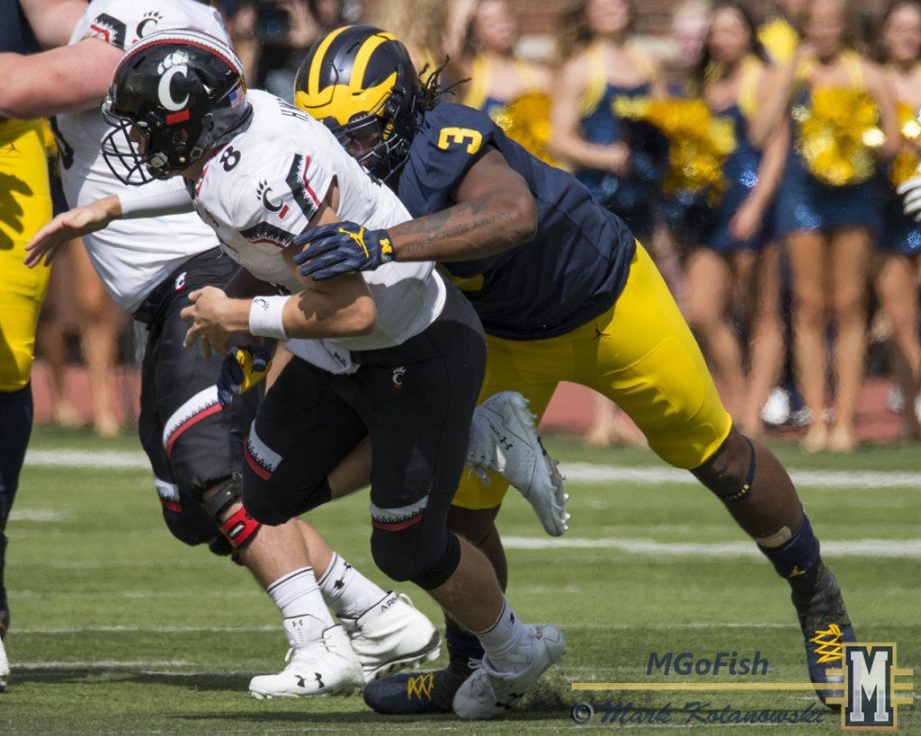 Rashan Gary hitting Cincinnati quarterback Hayden Moore during game at Michigan Stadium in Ann Arbor, Michigan on September 9th, 2017. Photo: Mark Kolanowski/MGoFish