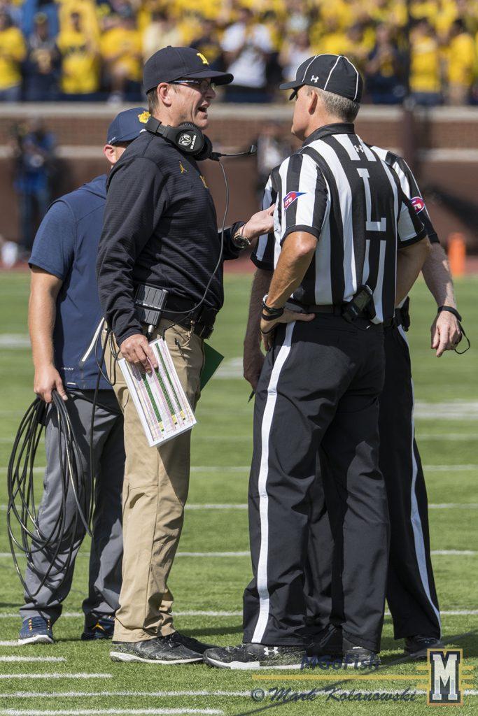 Jim Harbaugh speaking to the referees during game against Cincinnati at Michigan Stadium in Ann Arbor, Michigan on September 9th, 2017. Photo: Mark Kolanowski/MGoFish
