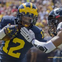 Chris Evans withe a run in the season opener against Cincinnati at Michigan Stadium in Ann Arbor, Michigan on September 9th, 2017. Photo: Mark Kolanowski/MGoFish