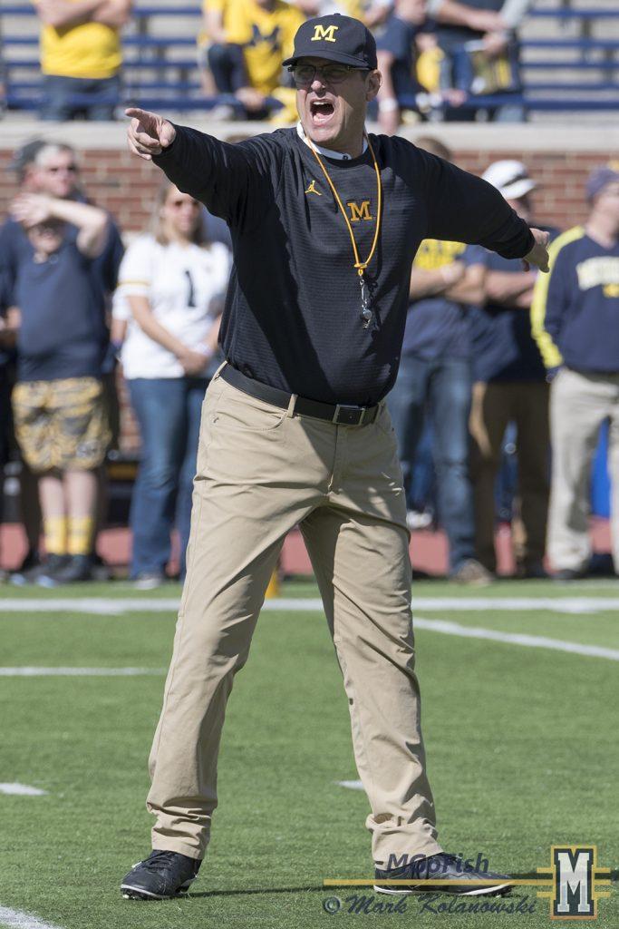 Jim Harbaugh speaking during warmups against Cincinnati at Michigan Stadium in Ann Arbor, Michigan on September 9th, 2017. Photo: Mark Kolanowski/MGoFish
