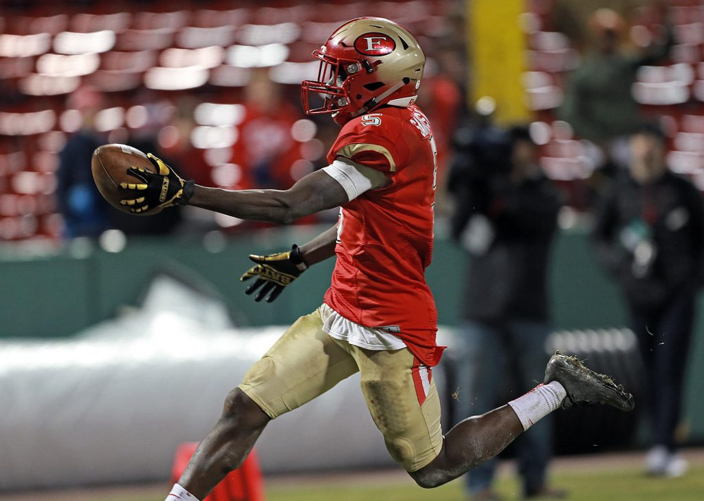 (Boston 11/22/17) Everett's Mike Sainristil runs in for a touchdown during the second half of the Gridiron Series at Fenway Park on Wednesday, November 22, 2017. Staff Photo by Matt Stone